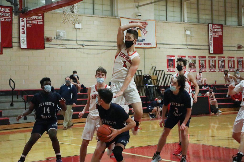 Senior Jack McBride defending his basket.
