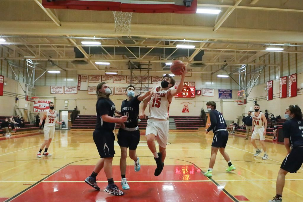 Senior Evan Williams gets a contested lay-up in the 4th quarter.