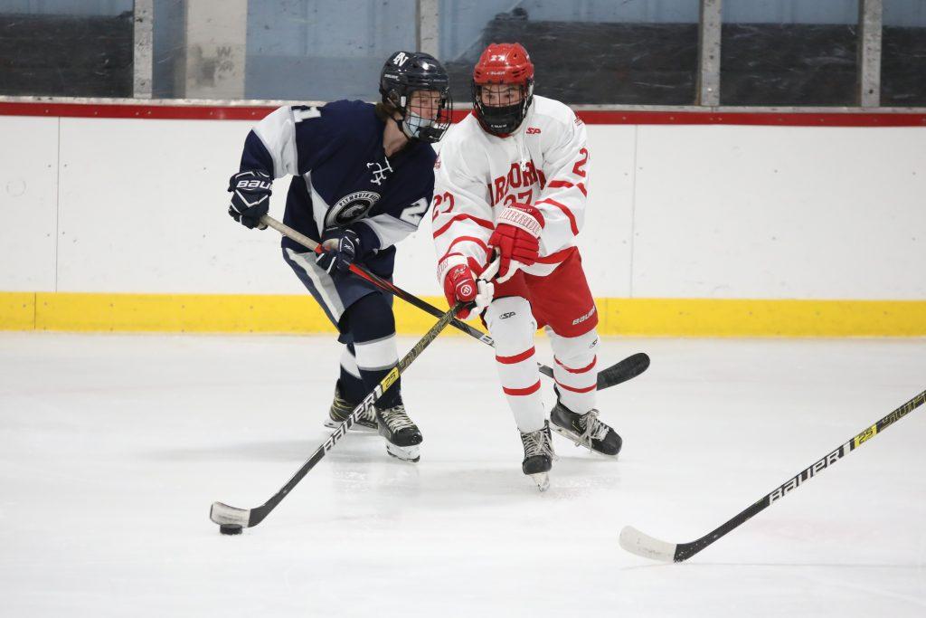 Sophomore Andrew Concannon  skates around a PN defender.