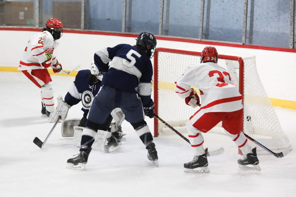 Junior Alex Barzowskas tips in his first career goal in the first period.