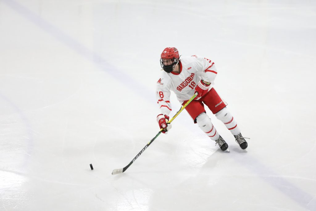 Junior Shay Crean brings the puck through center ice in the second period.