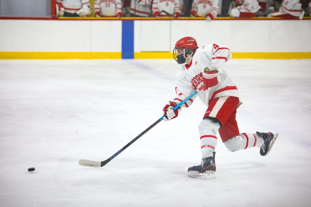 Junior defenseman Bobby Falvey is part of Hingham's shutdown defense.