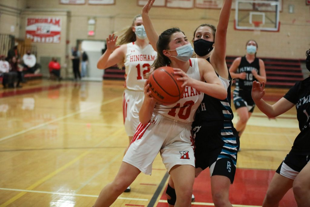 Senior captain Abbey Foley muscles her way to the basket.