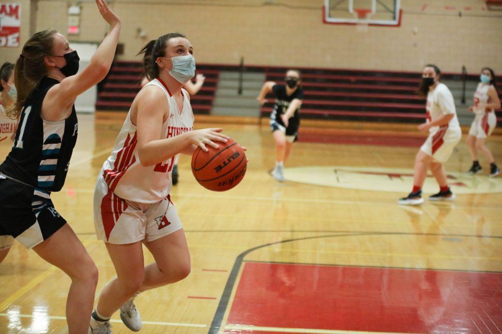 Sophomore Anabelle Platt looks to add to Hingham's lead.