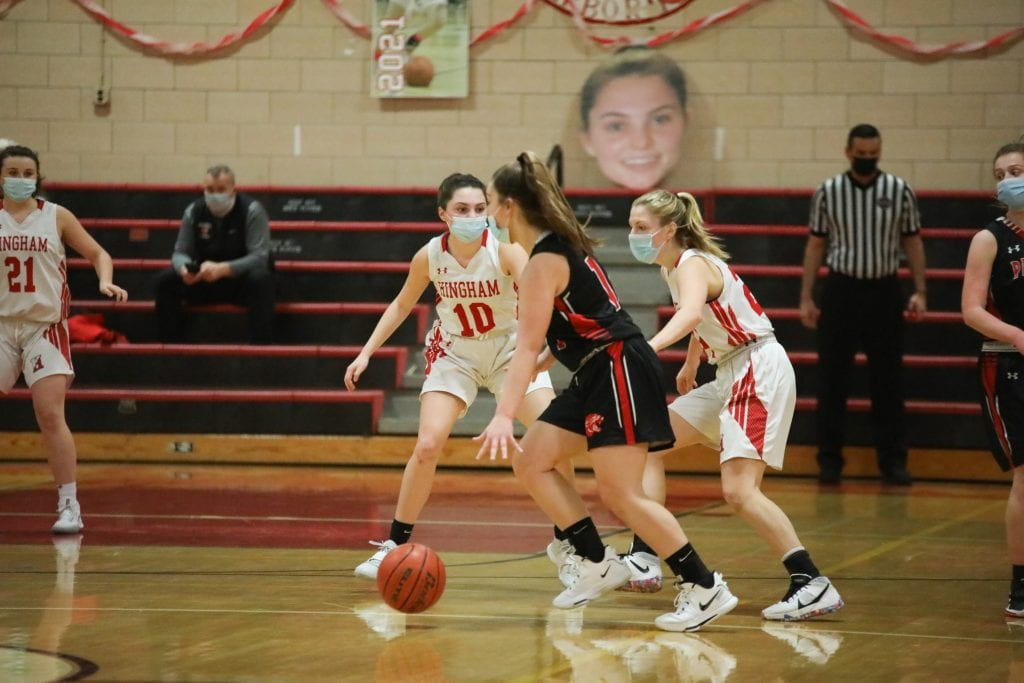 With her likeness plaster behind her, Abbey Foley plays tough defense.