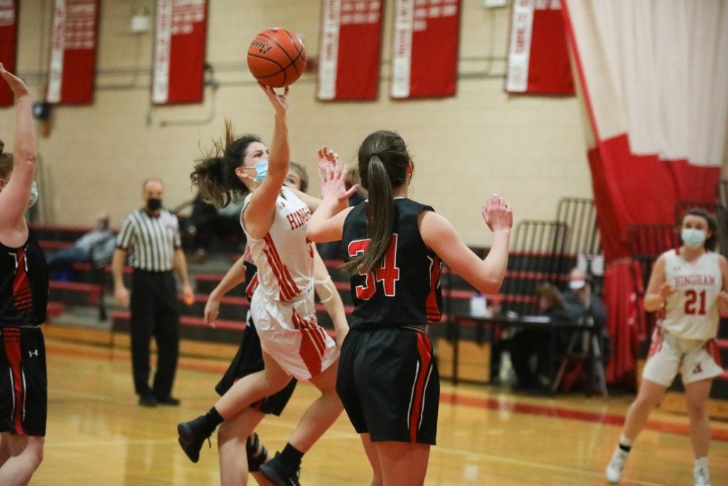 Sophomore Ellie Savitscus soars through the lane.