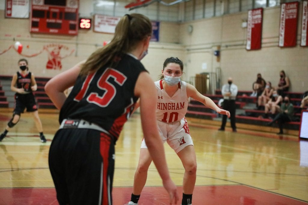 Abbey Foley attempting to seal the inbounds pass.