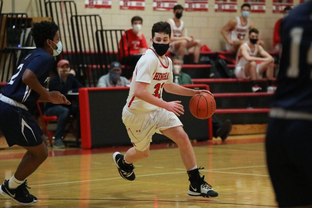 Senior Nik Willner looking for an opening under the basket.