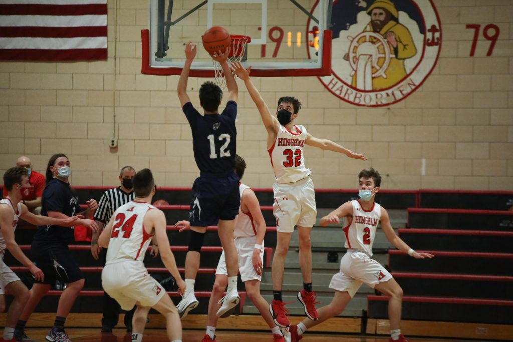 Sophomore Liam McBride extends to try and block a shot.