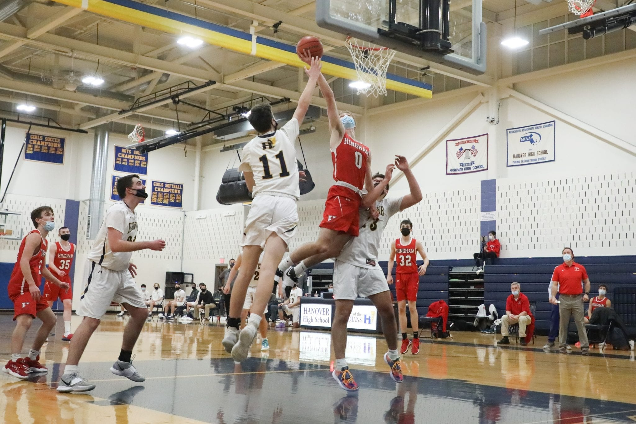 Senior captain Jack Hurley soars through the lane to tip in a rebound help to secure the victory for Hingham.