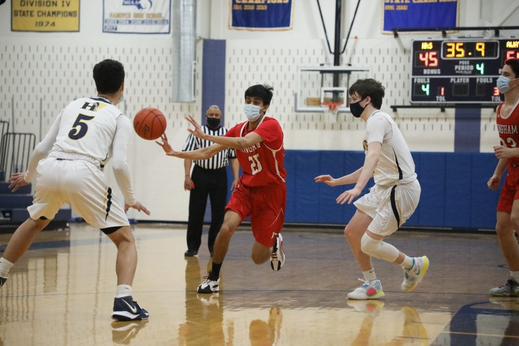 Senior Shrey Patel passes to a teammate as the clock winds down.