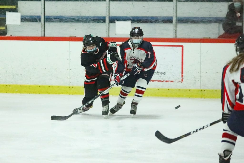 8th grader Caroline Doherty takes a shot in the first period.