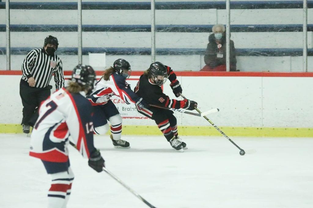 Junior Ryan Maguire skates around a Pembroke defender.
