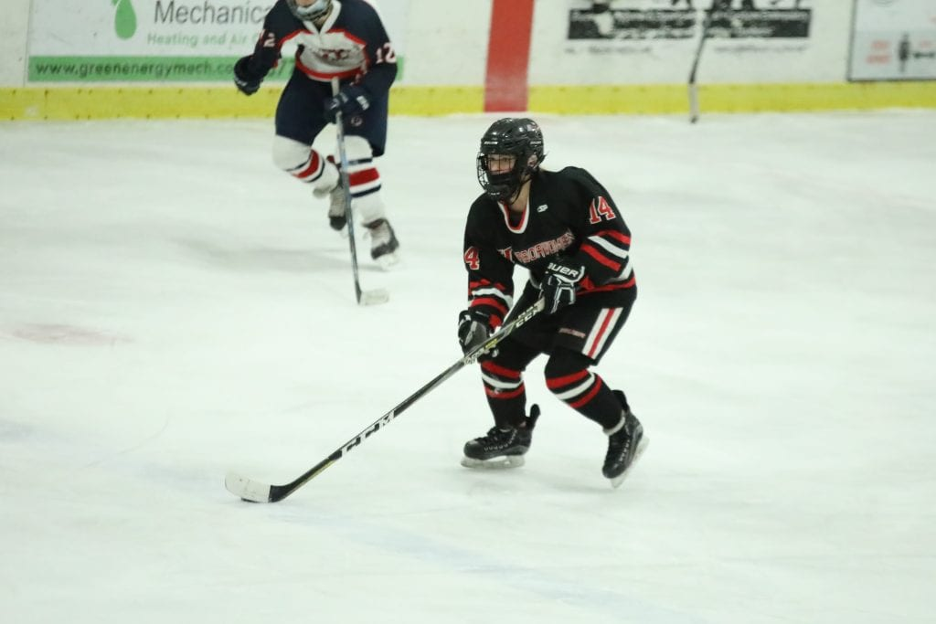 Sophomore Erin Packard carries the puck through the neutral zone.