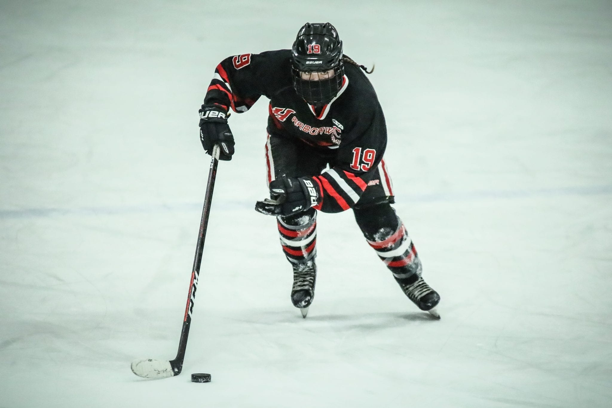 Junior captain Kathryn Karo skates up the ice during the second period of Hingham's 3-2 OT loss to Pembroke.