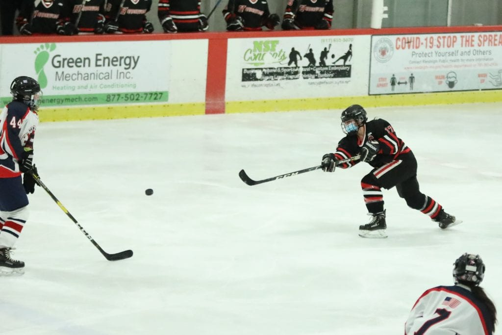 Senior captain Coco Hernberg fires the puck in the Pembroke offensive zone.