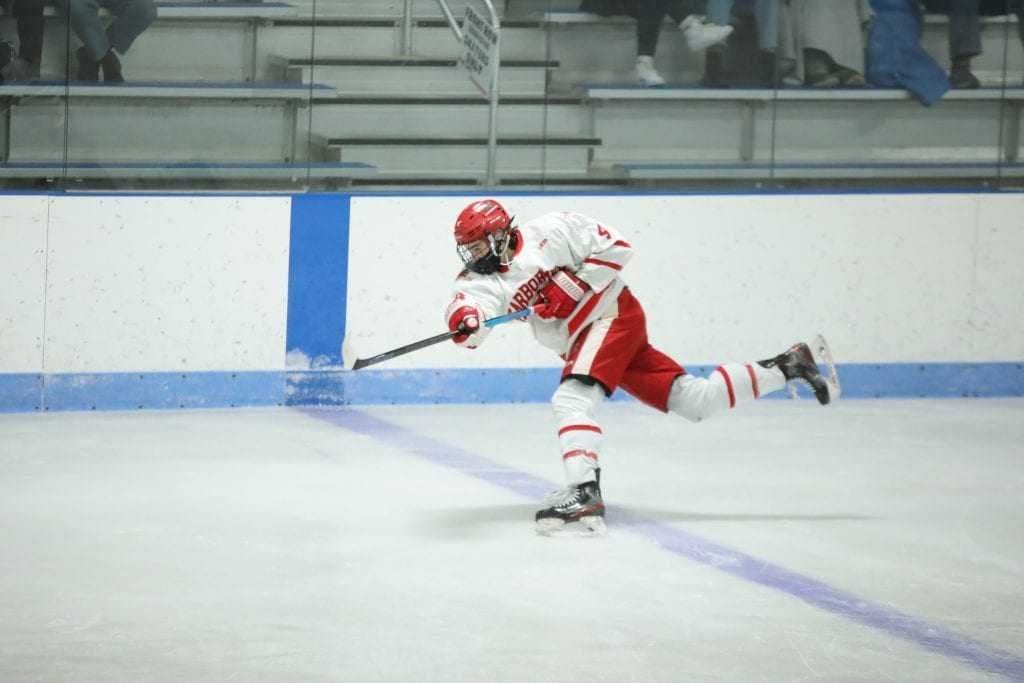 Junior Bobby Falvey fires one from the blue line.