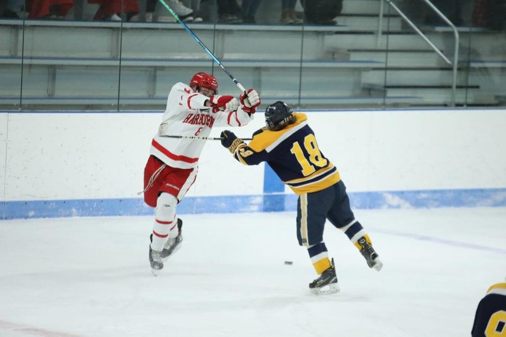Senior captain Ronan Mulkerrin collides with Hanover's senior captain Nate DelPrete at center ice.