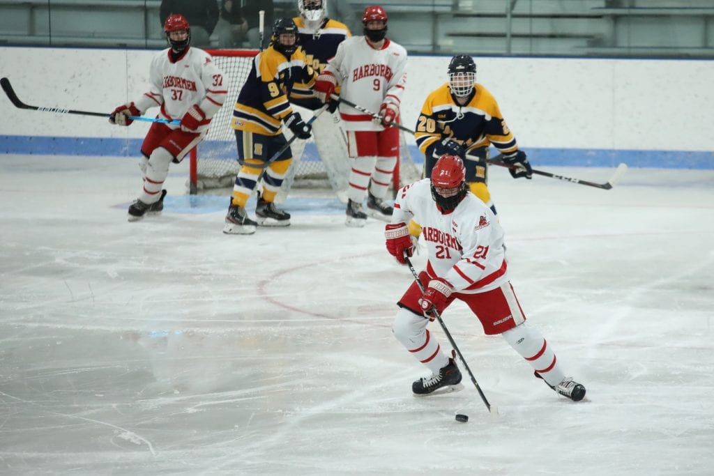Senior captain Paul Forbes keeps the puck in the Hanover end during a power play.