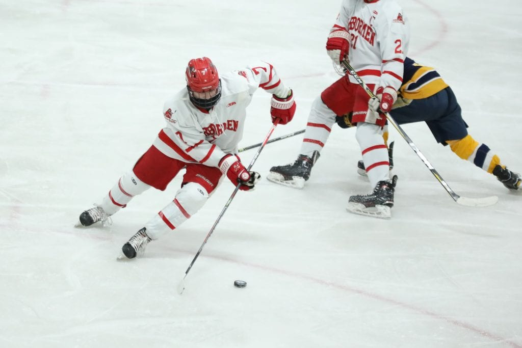 Sophomore Chase McKenna skates the puck out of his own end.