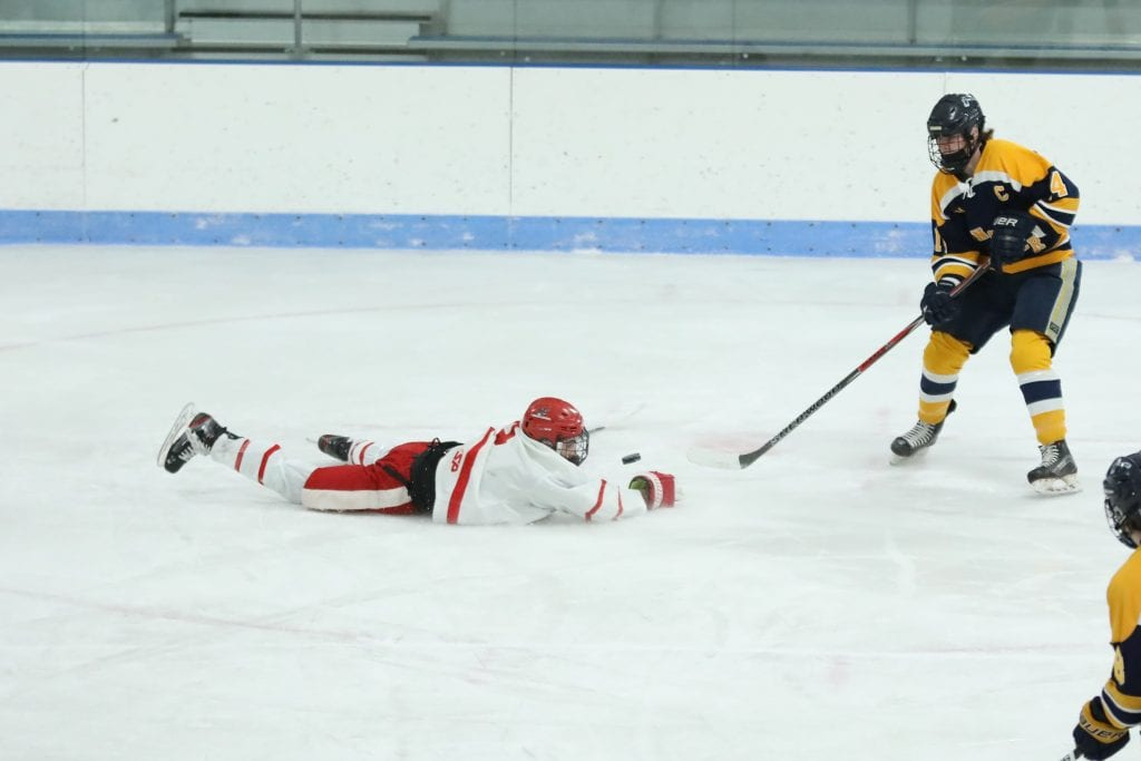Senior captain Paul Forbes lays out to block a shot.