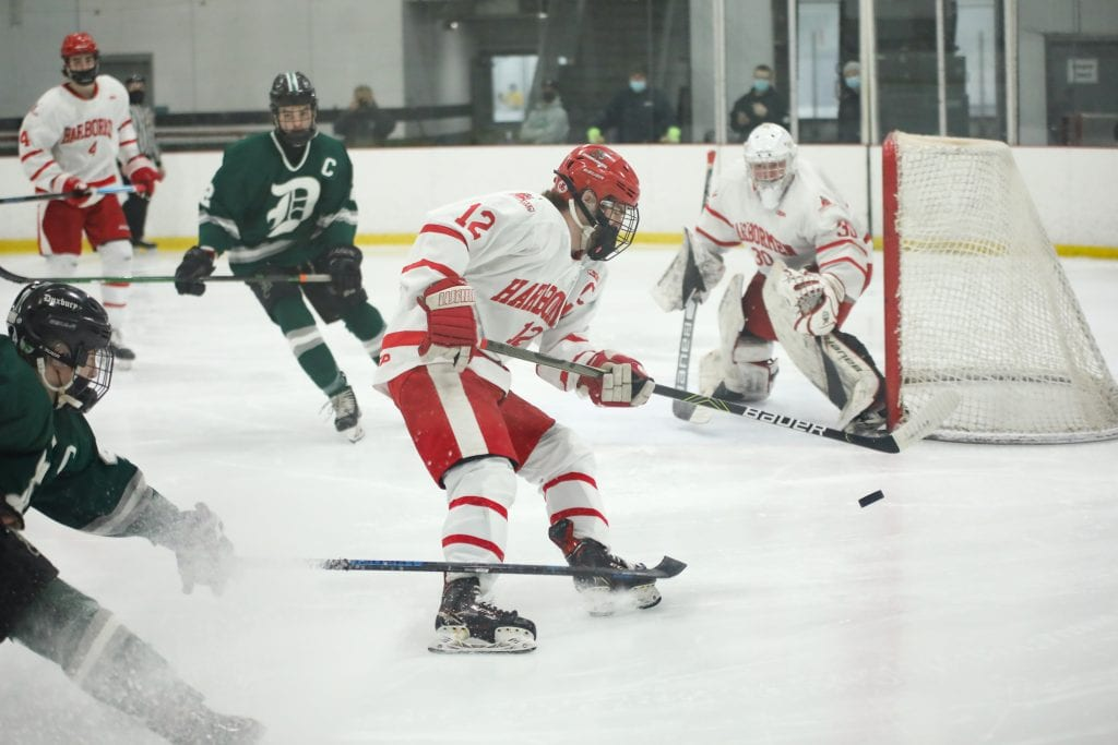 Senior captain Tommy McNally tracks the puck down in his defensive zone.