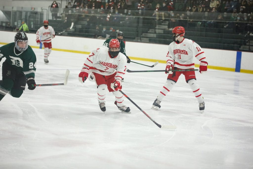 Sophomore Chase McKenna chases a puck down.