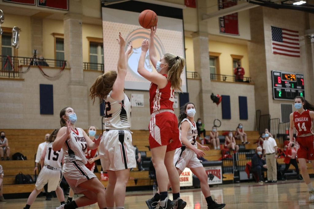 Junior Colleen Johnston pulls up for a jumper in the first quarter.