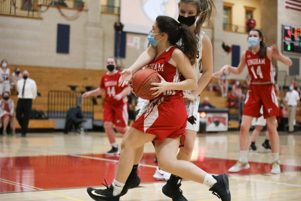 Sophomore Ellie Savitscus gets fouled on her drive to the basket.