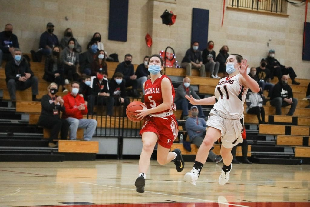 Sophomore Ellie Savitscus goes for the lay-up after stealing the ball.