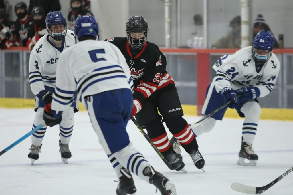 Sophomore Allu Linna skates into the Scituate end.