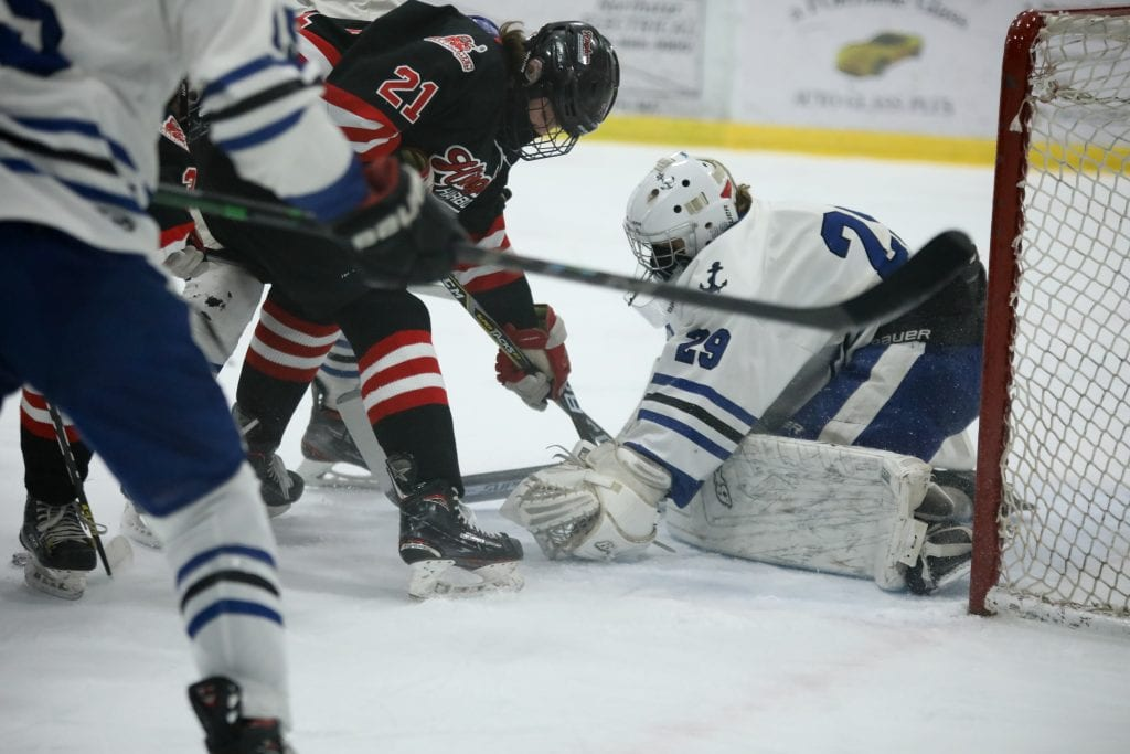 Senior captain Paul Forbes tries to poke the puck past the goalie in the first period.