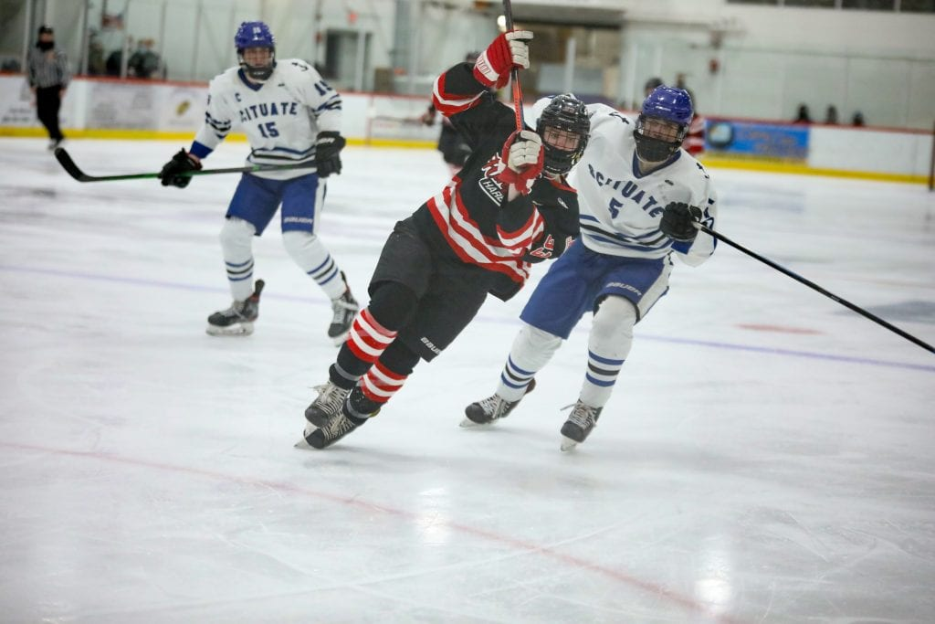 Junior Alex Barzowskas fights his way past a defender in the second period.