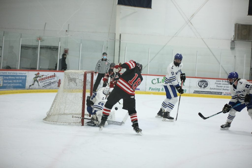 Senior Evan Corbett puts his first goal of the game past the goalie in the second period.