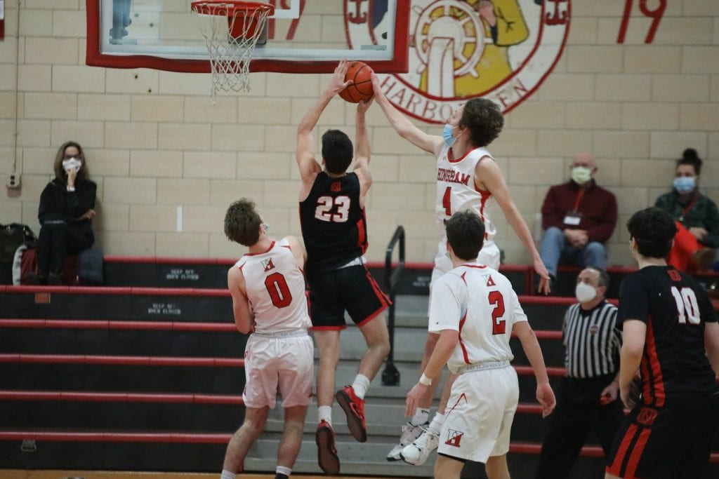 Junior Nick Johannes with a block from behind early in the game.