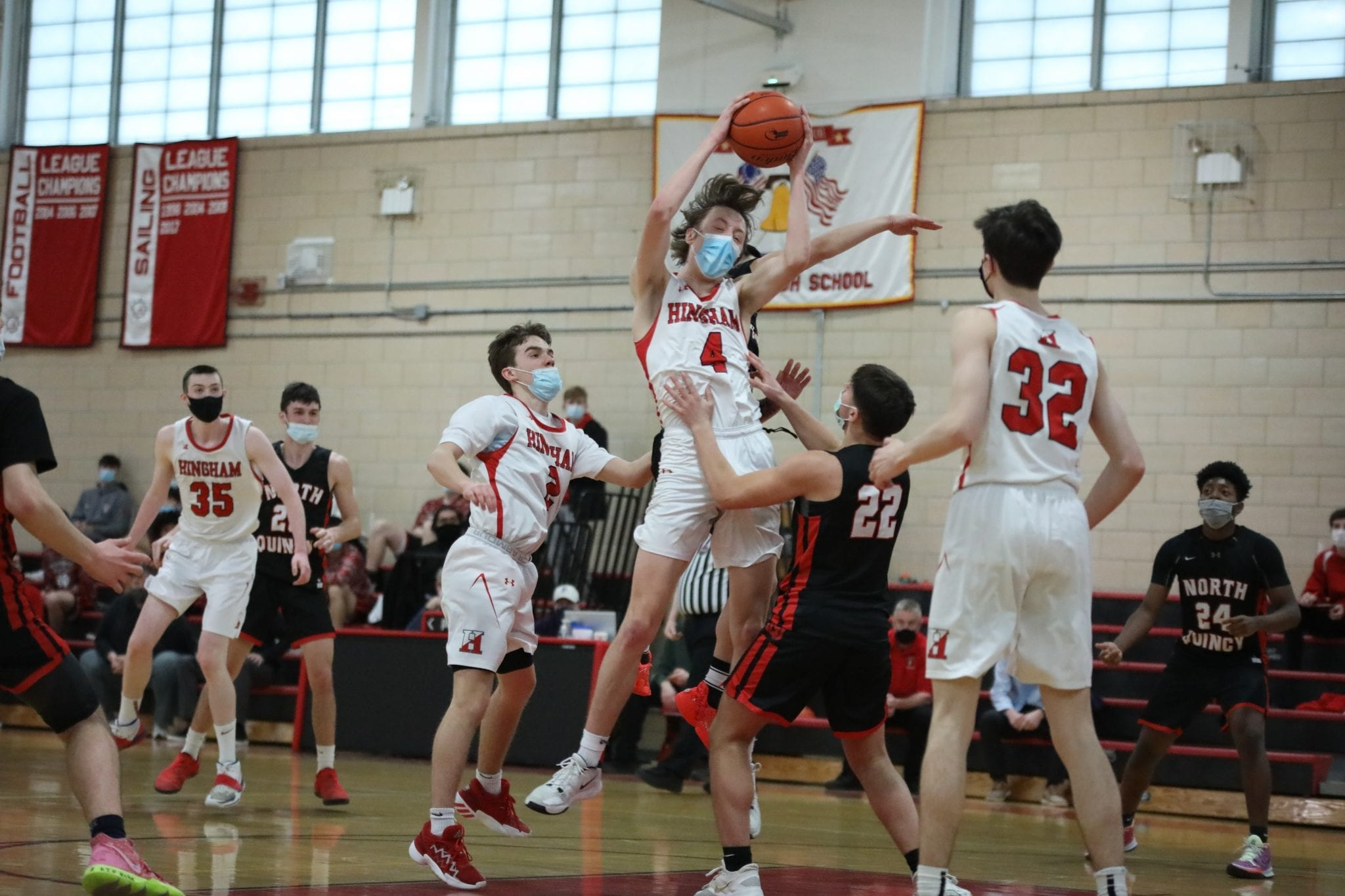 Junior Nick Johannes, who had a big night on both ends of the floor, grabs this rebound.