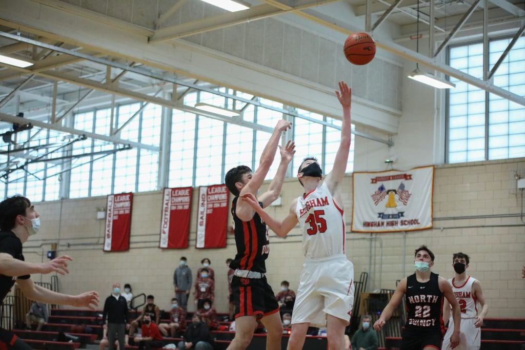 Senior Connor White gets a hand on this shot in the second quarter.