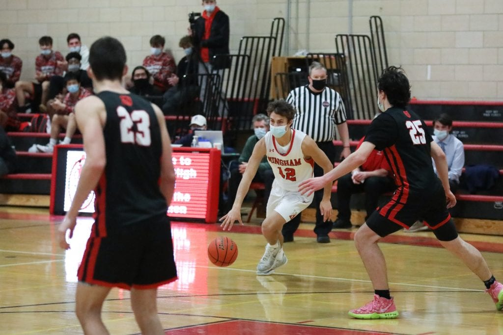 Junior John Sula puts the ball on the floor and drives to the basket.