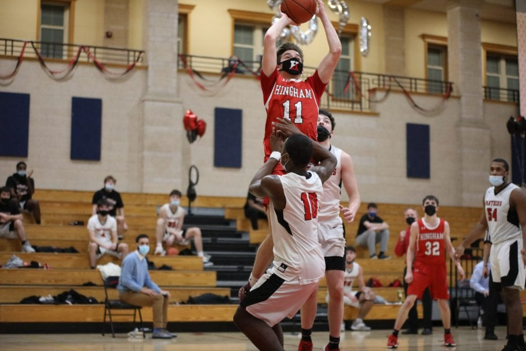 Senior Andrew Teague elevates on a shot under the basket.