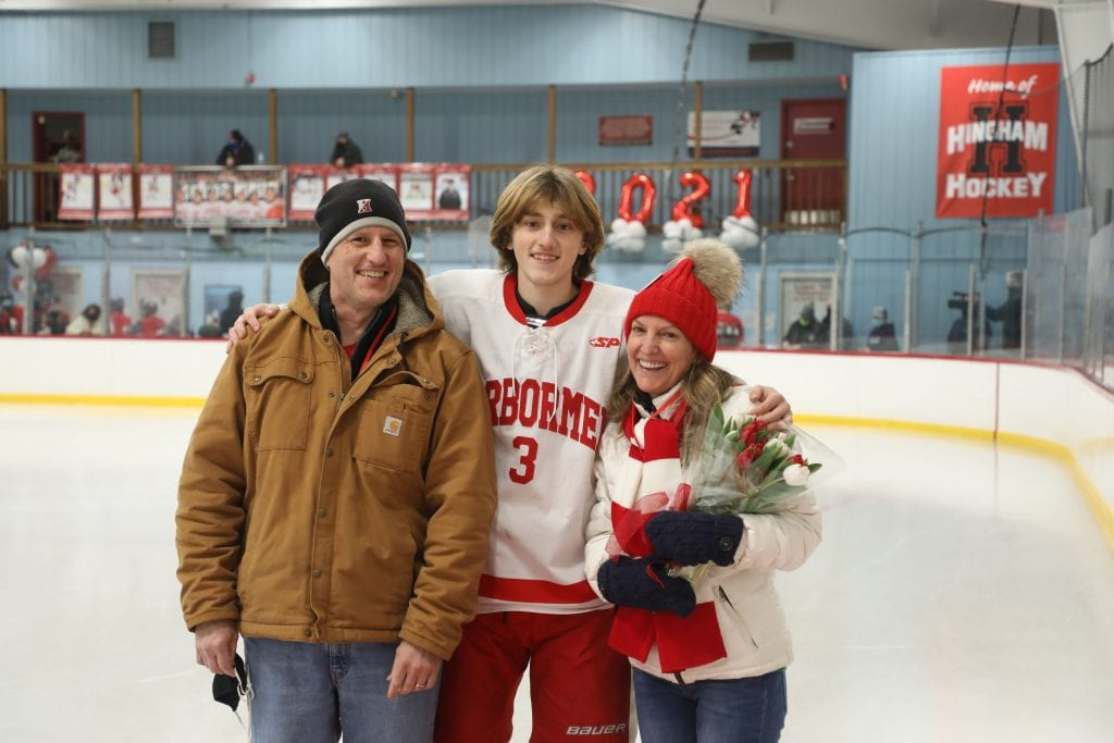 Lars Osterberg with his parents Shelly and Eric on senior night.