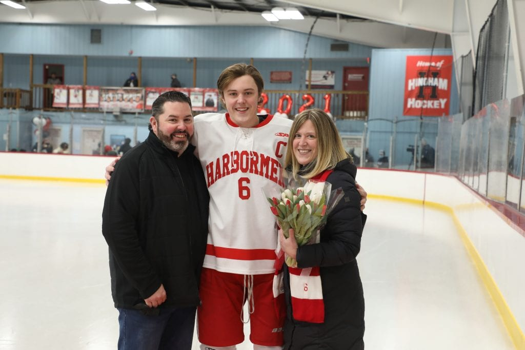 Captain Ronan Mulkerrin with his parents Andrea and Kevin on senior night.