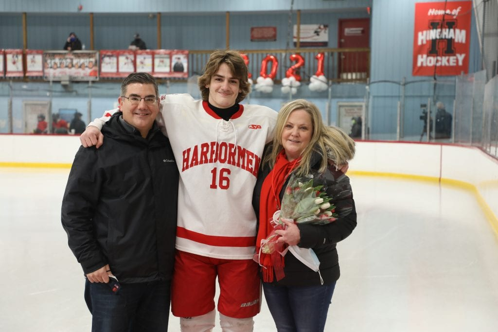 Evan Corbett with his parents Carol and Paul on senior night.