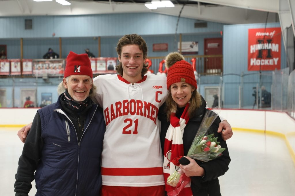 Captain Paul Forbes with his parents Katherine and Frank on senior night.