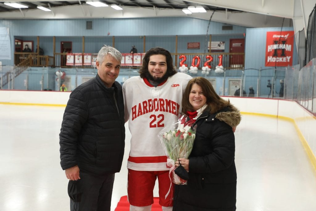 Jack Magner with his parents Michelle and John on senior night.