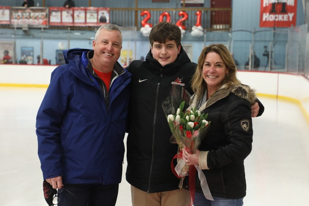 Team manager Will Shadrick with his parents Jen and Matt on senior night.