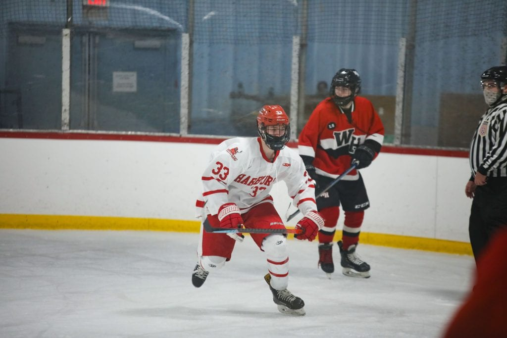 Junior Alex Barzowskas getting open in front of the net.