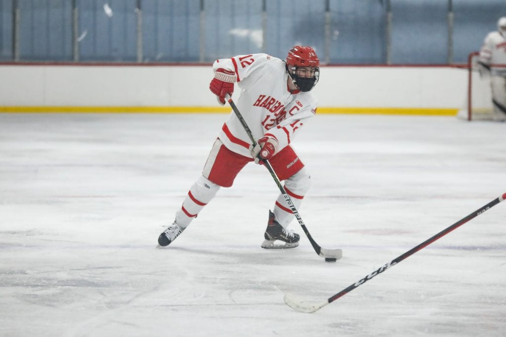 Senior Captain Tommy McNally moves the puck along the blue line.