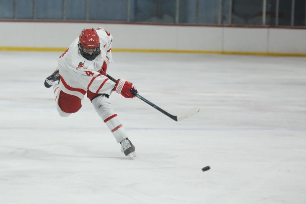 Junior Bobby Falvey fires the puck on a power play.