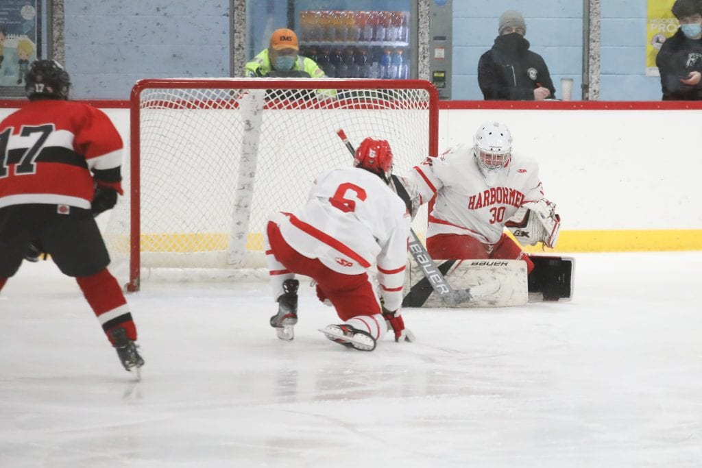 Senior Theo Jacobs makes a pad save.