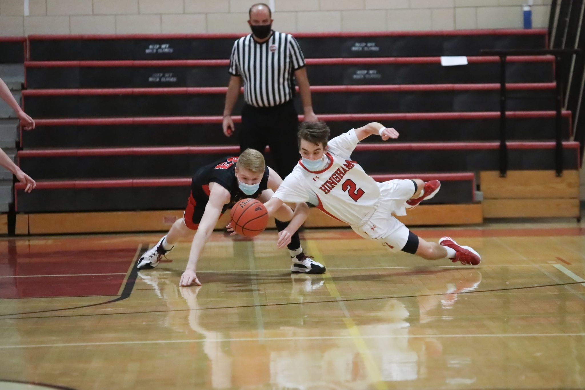 Junior Curtis Murphy dives for a loose ball during the game with Whitman-Hanson